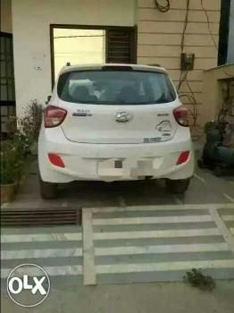 Hyundai Grand i10 1.2 Sportz (O) AT 2013